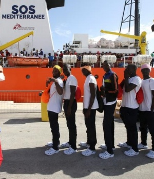 Migrants disembark from the MV Aquarius rescue ship, after being rescued by SOS Mediterranee organisation, in the Sicilian harbour of Trapani