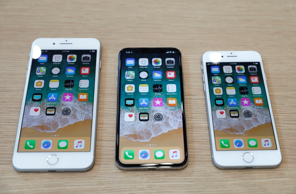 Different iPhone 8 models are displayed during an Apple launch event in Cupertino
