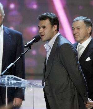 Singer Emin Agalarov speaks as his father Aras Agalarov and Donald Trump look on during a news conference after the 2013 Miss USA pageant in Las Vegas