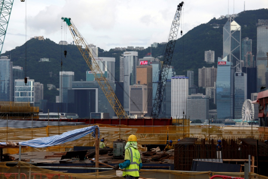 A worker stands on a construction site as part of the West Kowloon Terminus project for the Guangzhou-Shenzhen-Hong Kong Express Rail Link in Hong Kong