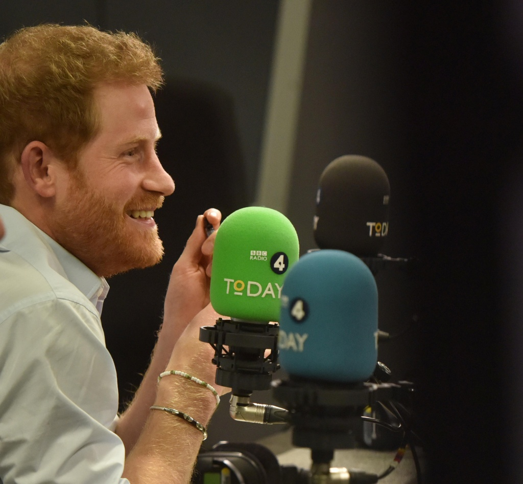 Britain's Prince Harry reacts as he guest edits the BBC's Radio 4 Today programme, in London