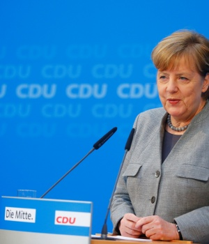 Acting German Chancellor Merkel address a news conference at the CDU party headquarters in Berlin