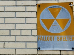 A yellow nuclear fallout shelter sign is seen hung on a building in the Brooklyn borough of New York