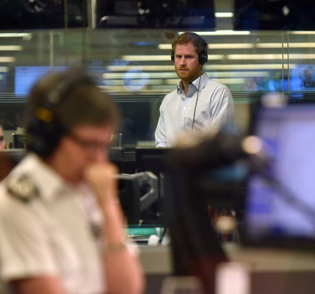 Britain's Prince Harry watches Metropolitan Police Commissioner, Cressida Dick, as he guest edits the BBC's Radio 4 Today programme, in London
