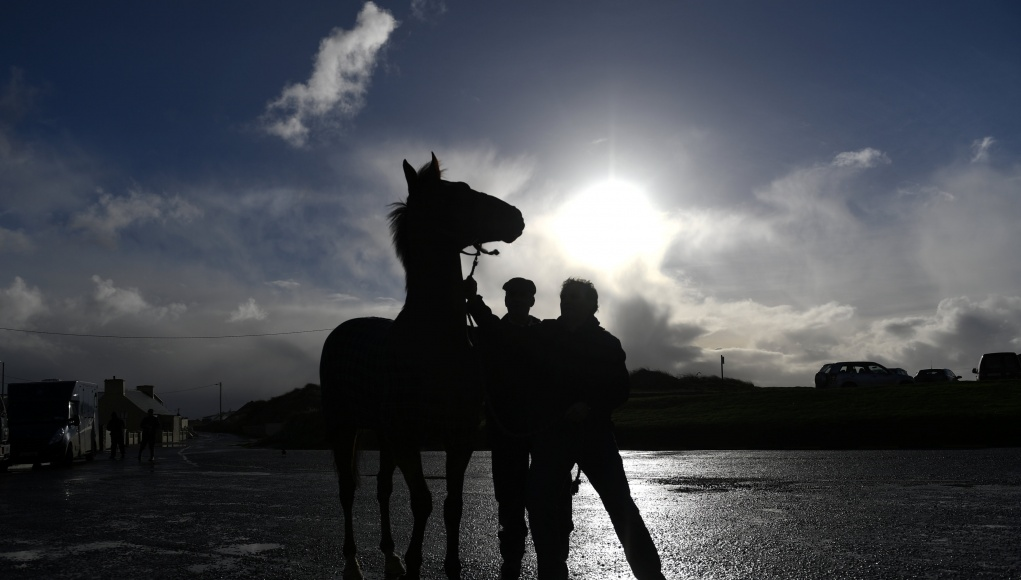 Jockeys and horses prepare to warm up before the Christmas Ballyheigue beach horse races in the County Kerry village of Ballyheigue