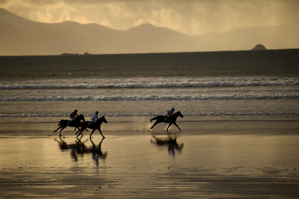 Runners and riders participate in the Christmas Ballyheigue beach horse races in the County Kerry village of Ballyheigue