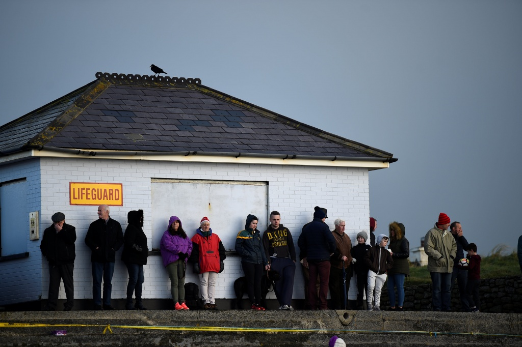 Spectators line up to watch a race, before the Christmas Ballyheigue beach horse races in the County Kerry village of Ballyheigue
