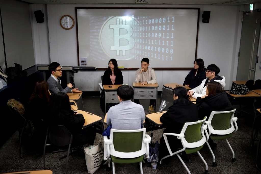 Members of a club studying cryptocurrencies, attend a meeting at a university in Seoul