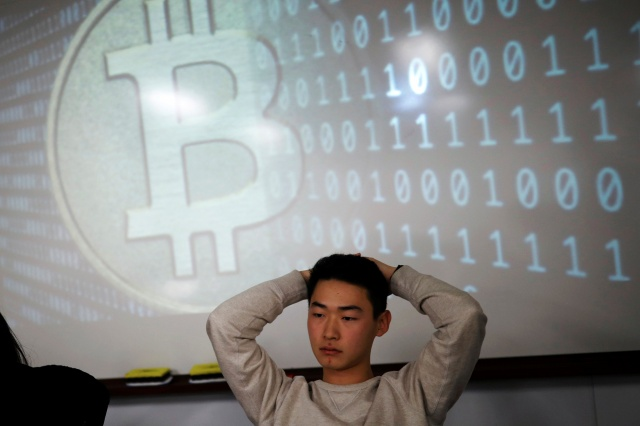 A university student, a member of a club studying cryptocurrencies, attends a meeting at a university in Seoul