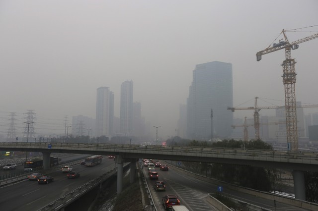 Vehicles drive towards the Central Business District amid heavy smog in Beijing