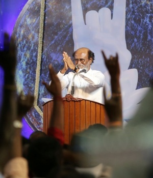 Actor Rajinikanth greets his supporters after announcing the launch of his political party in Chennai