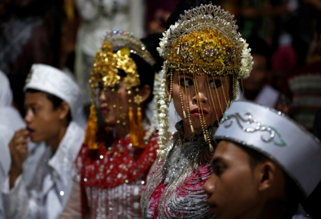 Couples take part in a mass wedding organised by the city government as part of New Year's Eve celebrations in Jakarta