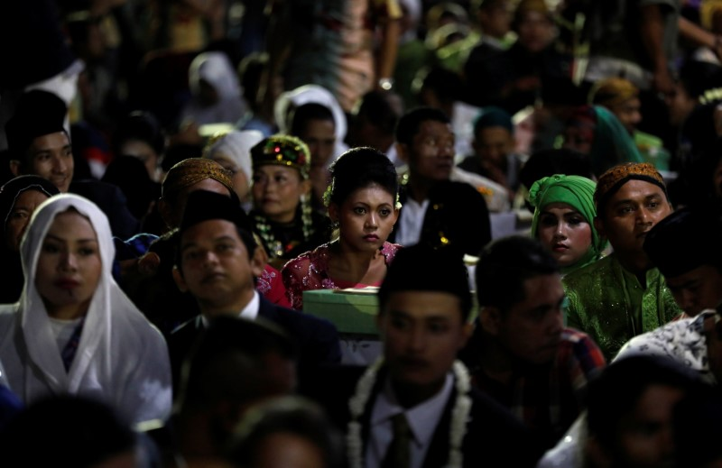 Couples take part in a mass wedding organised by the city government as part of New Year's Eve celebrations in Jakarta,