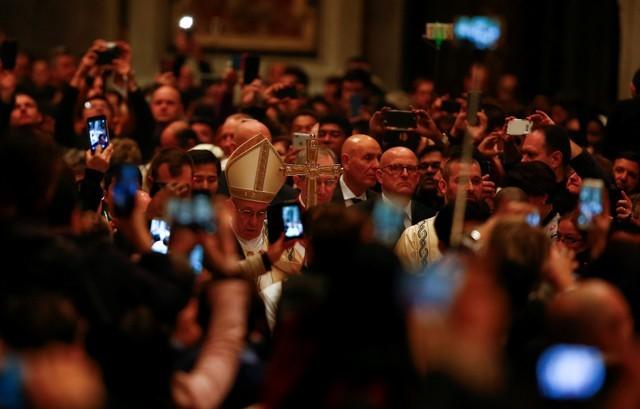 Pope Francis arrives to lead the First Vespers and Te Deum prayer in Saint Peter's Basilica at the Vatican