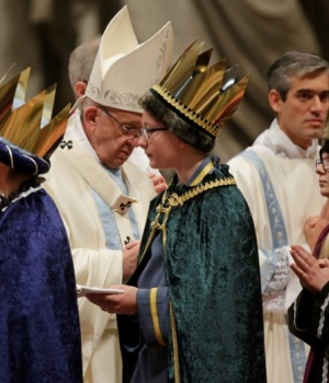 """Pope Francis greets faithful dressed as the """"Wise Men"""" as he leads a mass to mark the World Day of Peace in Saint Peter's Basilica at the Vatican"""