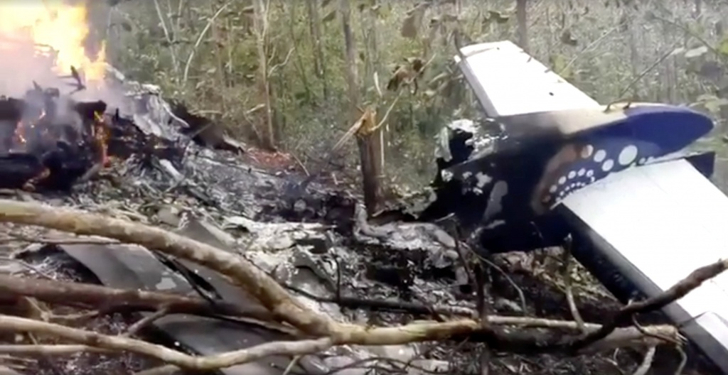Wreckage in flames after a plane crashed in the mountainous area of Punta Islita, in the province of Guanacaste, in Costa Rica