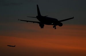 Aircraft come in to land and take off from Heathrow airport in London