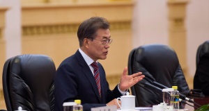 South Korea's President Moon Jae-In talks with China's Premier Li Keqiang at the Great Hall of the People in Beijing