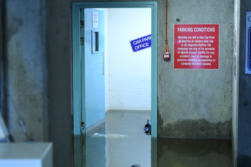 Flood water is seen at a doorway in a multi-storEy car park as flood waters reached up to 1.5 meters and destroyed multiple cars, in Galway