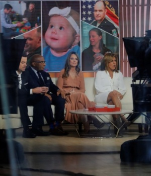 Co-hosts Hoda Kotb (R) and Savannah Guthrie sit with Al Roker on NBC's Today Show in New York