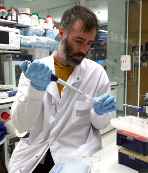 Dr Chris Millington, an investigator scientist, works in the lab at MRC Laboratory of Molecular Biology in Cambridge