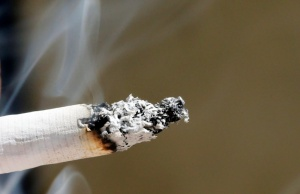 Smoke rises from a burning cigarette in Bordeaux