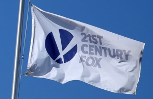 The Twenty-First Century Fox Studios flag flies over the company building in Los Angeles