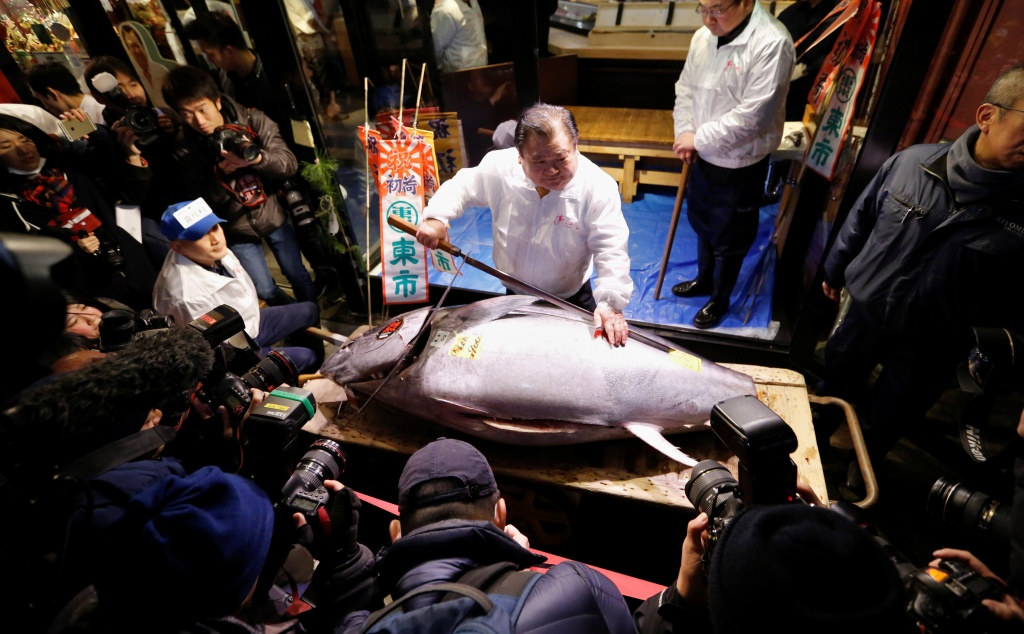 Kiyomura Co's President Kimura, who runs a chain of sushi restaurants Sushi Zanmai, poses with a 190 kg bluefin tuna, priced with a 30.4 million yen bid at the fish market's first tuna auction this year at his sushi re