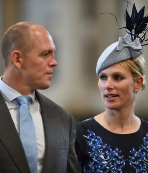 Britain's Zara Phillips and her husband Mike Tindall arrive for a service of thanksgiving for Queen Elizabeth's 90th birthday at St Paul's cathedral in London