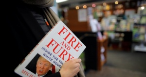 "A woman holds a copy of the book ""Fire and Fury: Inside the Trump White House"" by author Michael Wolff are seen at a local book store in Washington, DC"