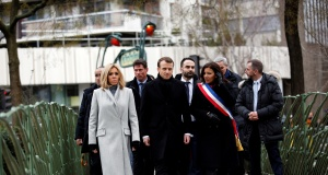 French President Emmanuel Macron his wife Brigitte and Paris mayor Anne Hidalgo arrive to observe a minute of silence in front of the plaque commemorating late police officer Ahmed Merabet to mark the third anniversary of the attack in Paris