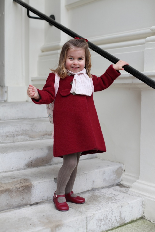 Britain's Princess Charlotte stands on the steps at Kensington Palace in a photograph taken taken by her mother and handed out by Britain's Prince William and Catherine, the Duchess of Cambridge