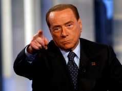 "Italy's former Prime Minister Silvio Berlusconi gestures as he attends television talk show ""Porta a Porta"" (Door to Door) in Rome"