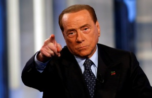 """Italy's former Prime Minister Silvio Berlusconi gestures as he attends television talk show """"Porta a Porta"""" (Door to Door) in Rome"""