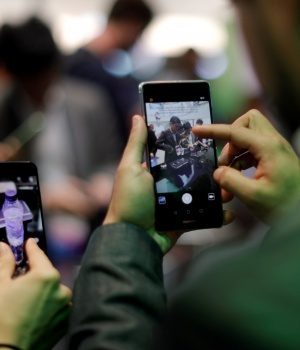 Visitors try Huawei's devices during Mobile World Congress in Barcelona
