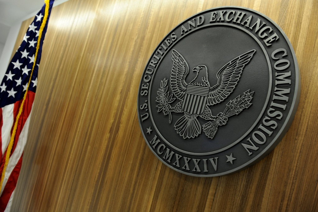 The seal of the U.S. Securities and Exchange Commission hangs on the wall at SEC headquarters in Washington