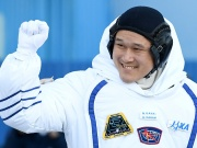 Norishige Kanai of the Japan Aerospace Exploration Agency (JAXA) during the send-off ceremony after checking their space suits before the launch of the Soyuz MS-07 spacecraft at the Baikonur cosmodrome