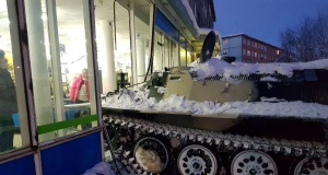 A view shows the scene of an incident involving an armoured personnel carrier which was rammed by a man into a shop window before climbing through the rubble to steal a bottle of wine, in the northern town of Apatity