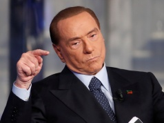 "Italy's former Prime Minister Berlusconi gestures during the taping of the television talk show ""Porta a Porta"" (Door to Door) in Rome"