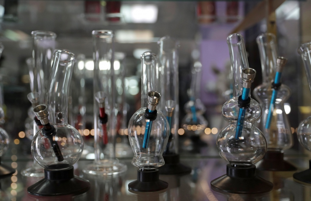 Cannabis pipes are displayed at Triparte shop in downtown Lisbon