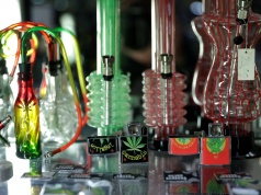 Cannabis pipes and lighters are displayed at Triparte shop in downtown Lisbon