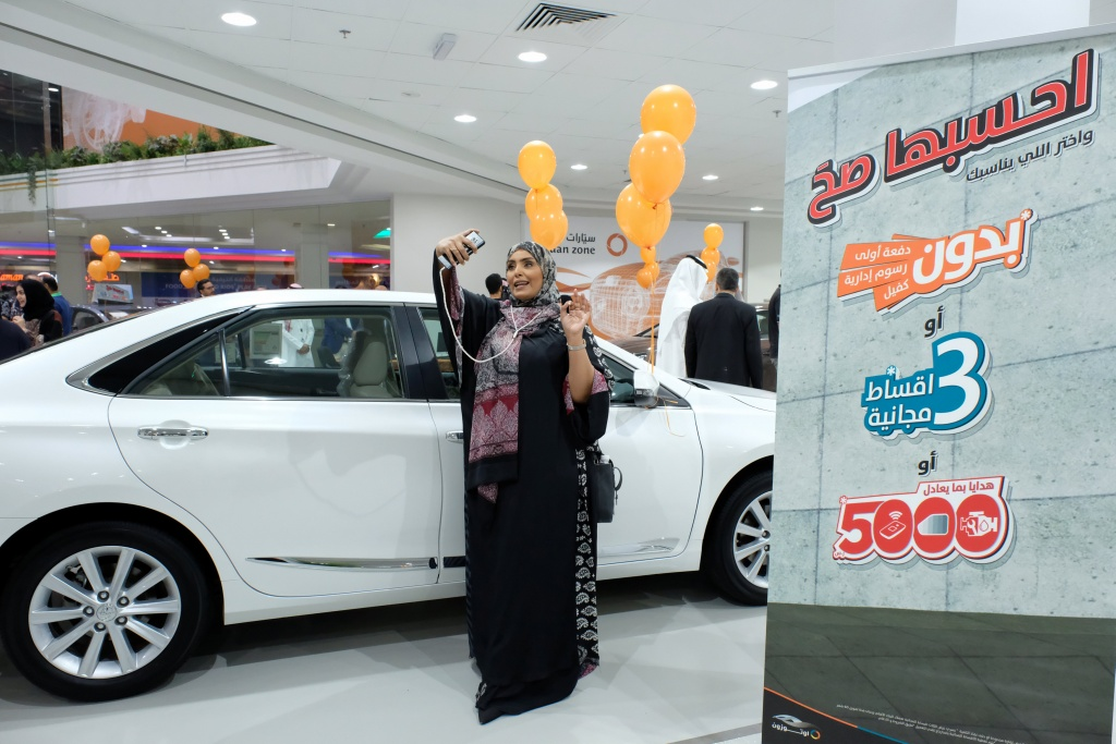 A Saudi woman is seen at the first automotive showroom solely dedicated for women, in Jeddah