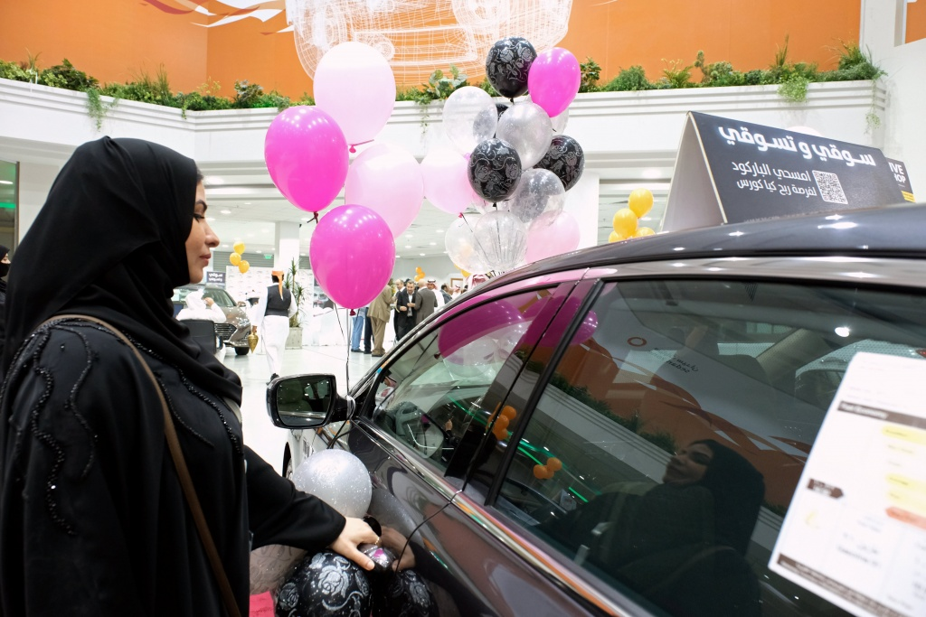 A Saudi woman checks a car at the first automotive showroom solely dedicated for women in Jeddah
