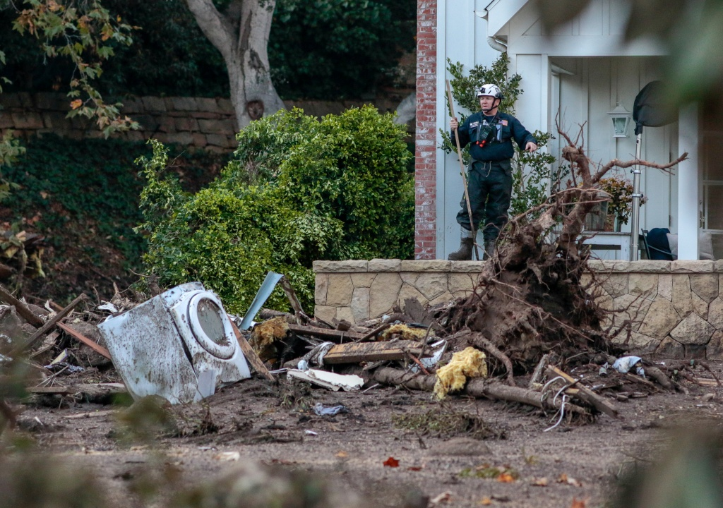 Rescue workers scour through properties after a mudslide in Montecito
