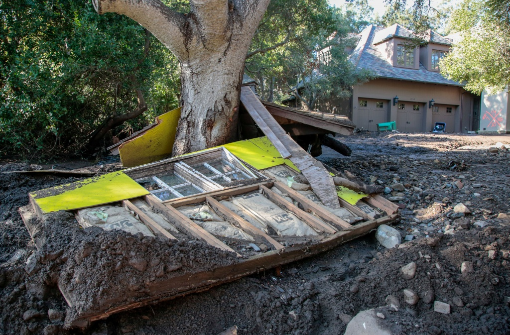 A destroyed house is seen after a mudslide in Montecito, California
