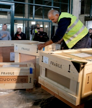 Workers unload boxes of artefacts at Beirut's International Airport