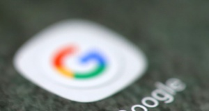 The Google app logo is seen on a smartphone in this picture illustration