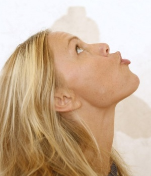 Yoga teacher Annelise Hagen demonstrates a facial muscle stretch that is a part of her face intensive yoga teachings in New York