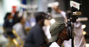Patients receive eye exams in a file photo