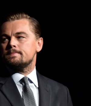 "US actor Leonardo DiCaprio looks on prior to speaking on stage during the Paris premiere of the documentary film ""Before the Flood"" in Paris"